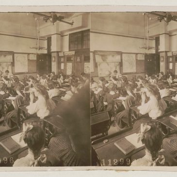 Photograph of 1908 geography class with students using stereoscopes.