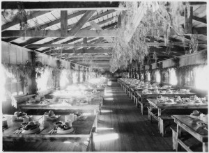 Photo of a Civilian Conservation Camp dining hall decorated for a holiday dinner