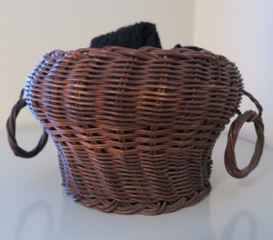 Photo of a two-handled hand-woven basket holding